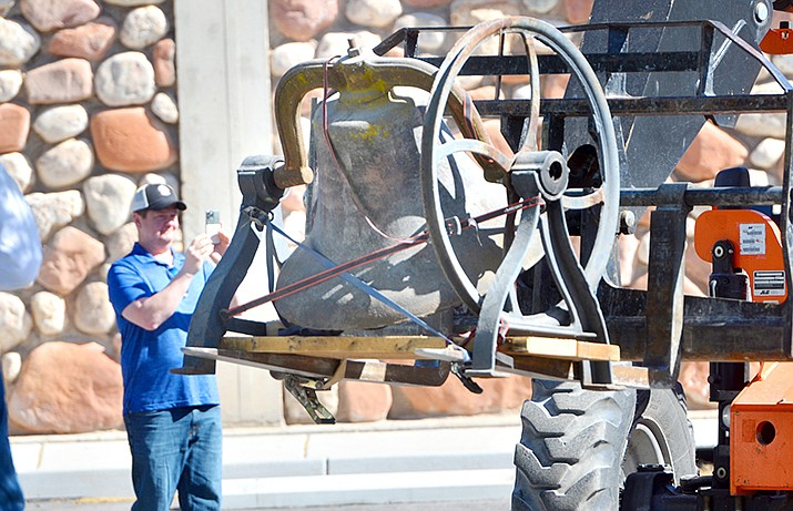 This bell was installed Monday, April 27 at Belfry Brewpub in Old Town Cottonwood. The bell is likely more than 100 years old. Owner Bob Conlin, pictured here on the left, said he hopes to open the multi-floor brewpub in late summer. VVN/Vyto Starinskas