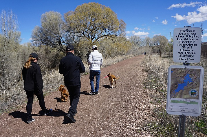 Usage at City of Prescott trails, parks and lakes has skyrocketed ever since the city announced that its recreational facilities would largely remain open during the coronavirus (COVID-19) pandemic. Soon after the start of the shut-down in late March 2020, a family walks along the popular Peavine Trail. (Cindy Barks/Courier file)