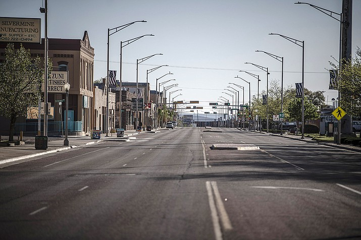This May 1 photo shows a street in Gallup, N.M., following the governor's order to go in lockdown. New Mexico Gov. Michelle Lujan Grisham is ordering workers at retail stores and restaurants to wear face coverings as a precaution against the spread of COVID-19, starting with larger retail stores and major grocery stores on Wednesday. (Roberto E. Rosales/The Albuquerque Journal via AP)