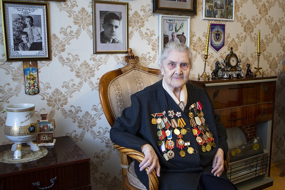 In this photo taken on Thursday, April 30, 2020, Valentina Efremova, a 96-year-old World War II veteran, who served as a nurse in field hospitals on the frontlines throughout the war, speaks during her interview with the Associated Press in Yakutsk, Russia . (AP Photo/Alex Lee)