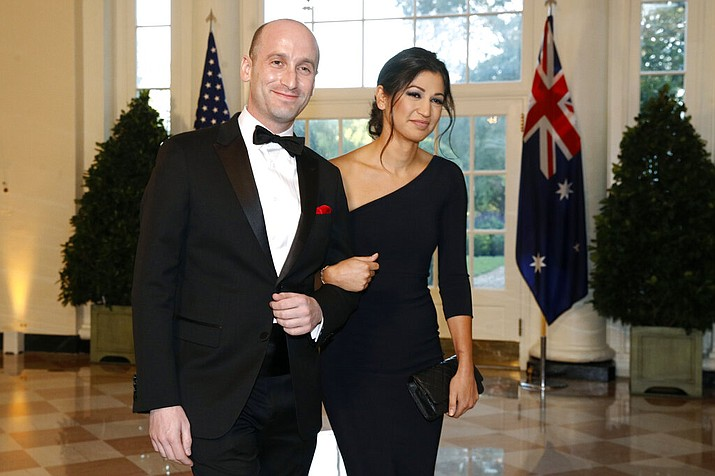 In this Sept. 20, 2019, file photo President Donald Trump's White House Senior Adviser Stephen Miller, left, and Katie Waldman, now Miller, arrive for a State Dinner with Australian Prime Minister Scott Morrison and President Donald Trump at the White House in Washington. Vice President Mike Pence's press secretary has the coronavirus, the White House said Friday, making her the second person who works at the White House complex known to test positive for the virus this week. Pence spokeswoman Katie Miller, who tested positive Friday, May 8, 2020, had been in recent contact with Pence but not with the president. (AP Photo/Patrick Semansky, File)