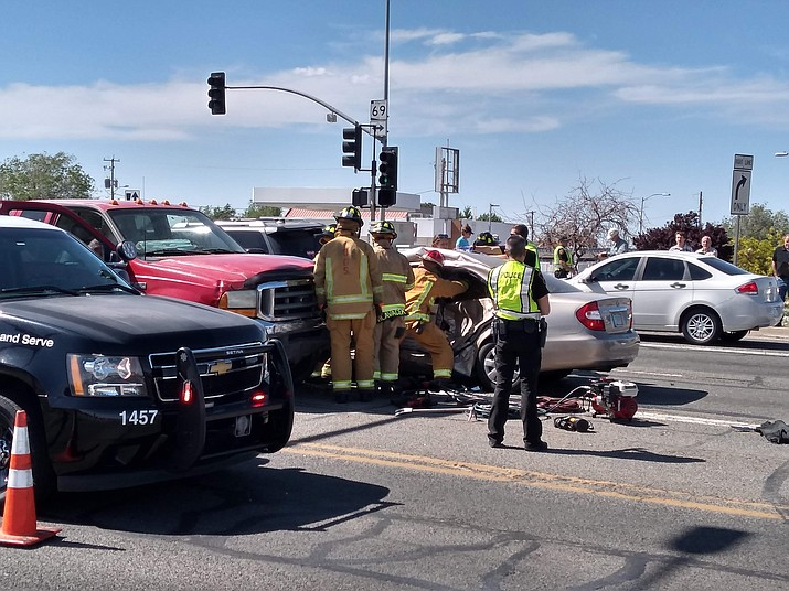 Firefighters work to remove an injured person from a vehicle at the three-vehicle crash at Robert Road and Highway 69 on Friday afternoon, May 8, 2020. (Jesse Bertel/Courier)