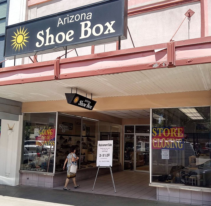 """Arizona Shoebox in downtown Prescott displays """"going out of business,"""" """"store closing"""" and """"retirement sale"""" signs on Wednesday, May 6, 2020. (Jesse Bertel/Courier)"""