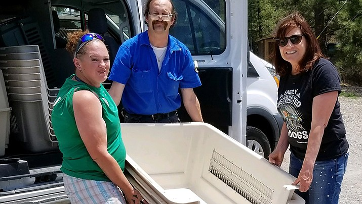 Emily Steele Black of the Mohave County Animal Shelter, left, and Lynn Kannianen, president of Friends of Mohave County Animal Shelter, right, load 15 extra-large crates donated to the shelter by the Coconino Humane Society. (Photo courtesy of Friends)