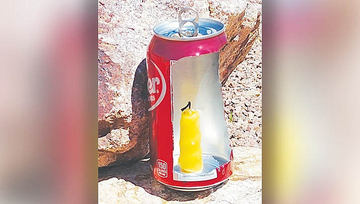 A lantern can be made using a soda can. (Photo by Luis Vega/For the Miner)
