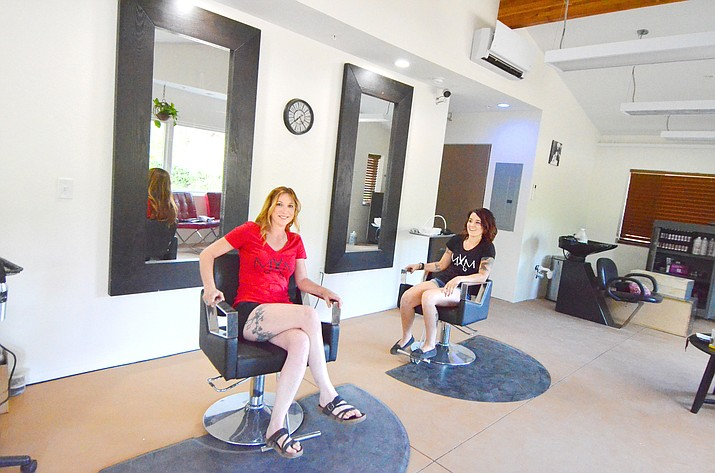 Candy Dawn, left, and Amanda Campbell take a quick break for a photo at Mane by Main Hair Salon in Cottonwood. VVN/Vyto Starinskas