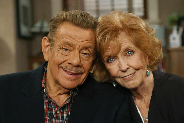 """In this Nov. 6, 2003, file photo, Jerry Stiller, left, and his wife Anne Meara pose on the set of """"The King of Queens,"""" at Sony Studio in Culver City, Calif. Stiller, a comedy veteran who launched his career opposite wife Meara in the 1950s and reemerged four decades later as the hysterically high-strung Frank Costanza on the smash television show """"Seinfeld,"""" died of natural causes at the age of 92, his son Ben Stiller announced Monday, May 11, 2020. (AP Photo/Stefano Paltera, File)"""