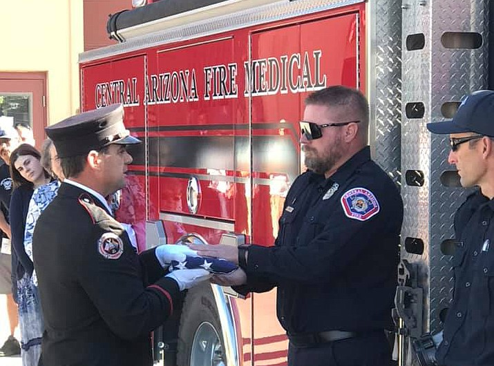A flag-lowering ceremony was held May 7 at fire station 62 for the Central Arizona Fire and Medical Authority in Chino Valley for paramedic firefighter Dan Gnagey, who is retiring after 16 years of service with the department. (CAFMA/Courtesy)