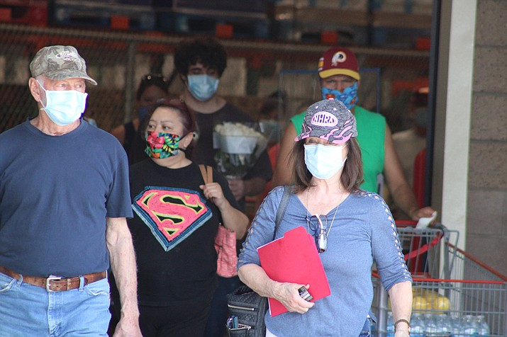 Customers waiting to get into the Prescott Costco on Saturday, May 9, 2020, all wear face masks — a new requirement by the warehouse retailer this past week. Mayors from the tri-city area told the Chino Valley Review they do not plan to institute similar requirements as area businesses and government offices gradually reopen. (Brian Haddad/For the Courier)