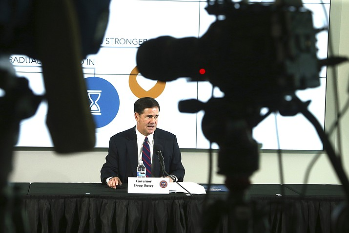 Arizona Republican Gov. Doug Ducey speaks at a news conference regarding the latest updates on the coronavirus May 4, in Phoenix. (AP Photo/Ross D. Franklin, Pool)