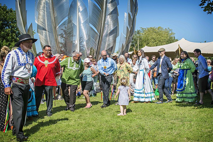 Chief Gary Batton leads Choctaw and Irish dancers in the traditional Choctaw Snake Dance at the 2017 dedication ceremony for the sculpture Kindred Spirits in Bailick Park in Midleton, County Cork, Ireland. Donations from across Ireland have been made to the Navajo Nation and Hopi reservation during the global pandemic as a way of paying forward the kindnesss that was given to the Irish people in 1847. (Courtesy of Deidre Elrod/Choctaw Nation)