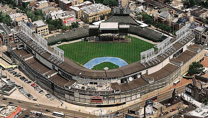 Major League Baseball owners have approved a plan to begin play in July. The players will also have to agree. Wrigley Field in Chicago is shown. (Photo by Towpilot, cc-by-sa-3.0, https://bit.ly/2WTAXSC