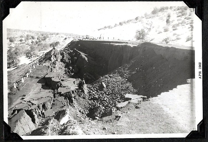 People gather around a cave-in on Route 66 between Ash Fork and Williams in 1962. (Photo/Messimer family)