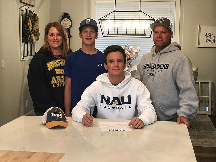 Prescott football's Clay Gross and his family pose for a photo after he signed his letter of intent to continue his athletic career at Northern Arizona University (NAU) this fall. (Clay Gross/Courtesy)