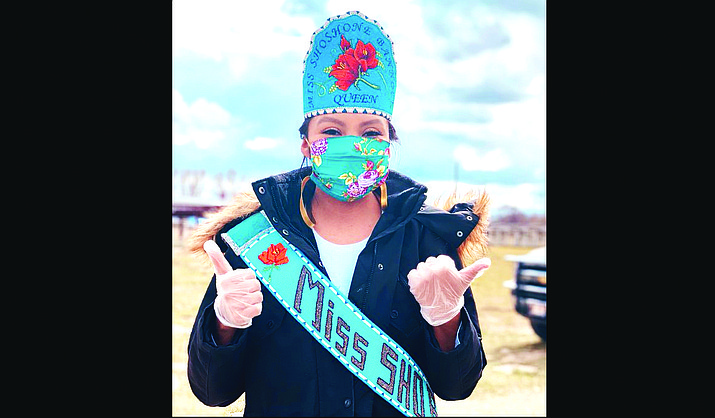 Stormie Perdash, who holds the title Miss Shoshone-Bannock, poses wearing one of her homemade masks after helping distribute food to those affected by the pandemic. (Photo courtesy of Stormie Perdash)