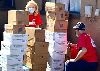 Cindy Rioux, director of the Salvation Army in Williams helps sort boxes to be donated to those in need. (Photo/Gayle Stafford)