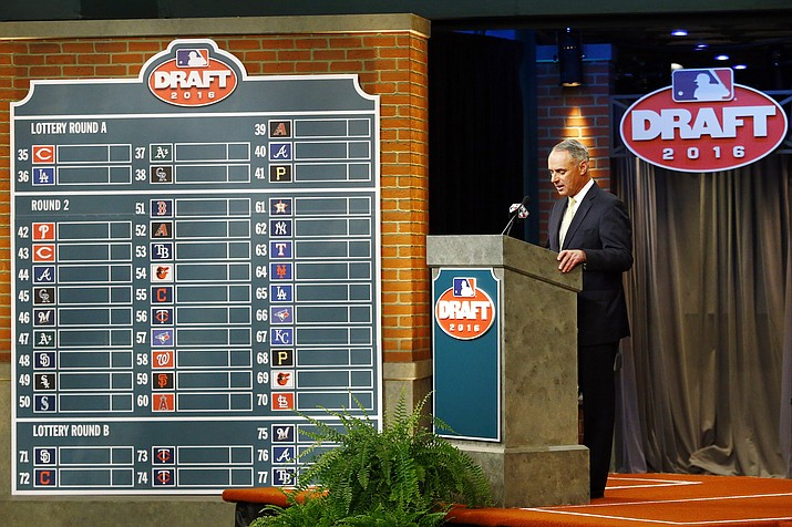 In this June 9, 2016 photo, MLB Commissioner Rob Manfred speaks during the MLB draft, in Secaucus, N.J. Major League Baseball will cuts its amateur draft from 40 rounds to five this year, a move that figures to save teams about $30 million. (Julio Cortez/AP, File)