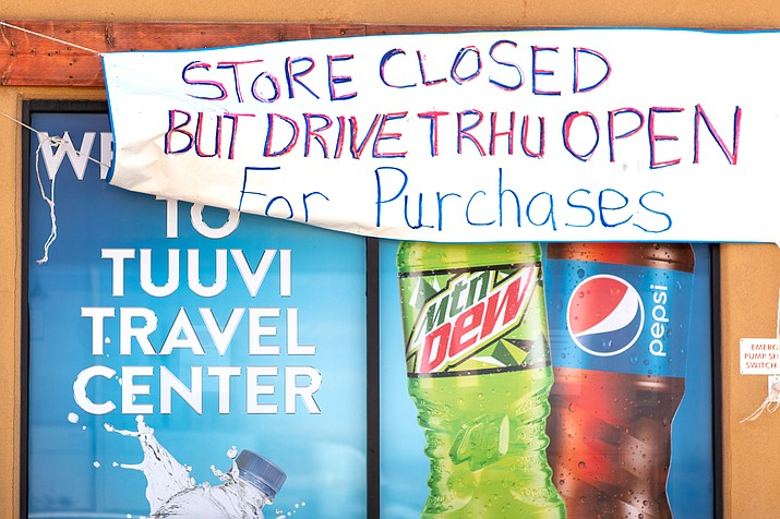 Tuuvi Travel Center in Moenkopi, Arizona informs travelers that the main store is closed and with only the drive thru window open for business. Navajo Nation President Jonathan Nez announced May 13  that the Nation has extended an executive order declaring a state of emergency and government closures to June 7 in an attempt to minimize the spread of the coronavirus. (Photo courtesy of Gilbert Honanie)