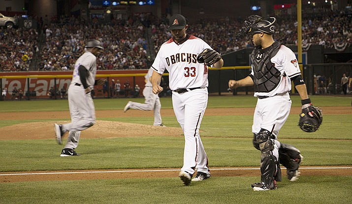The relationship between pitcher and catcher, like that of former Diamondbacks pitcher Jake Barrett (left) and catcher Welington Castillo is key to the success of a team. (Photo by Kris Vossmer/Cronkite News)