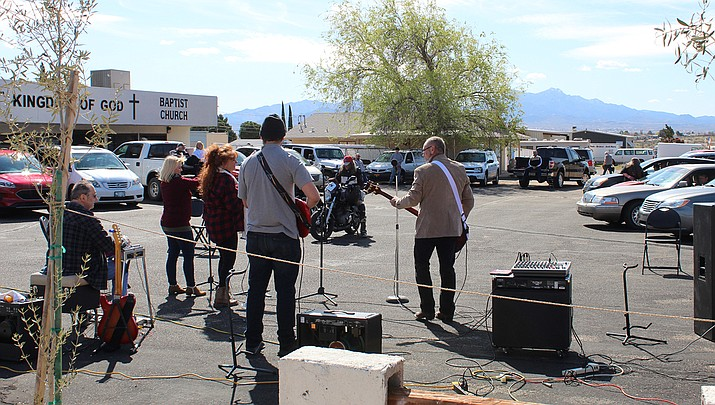 Musicians perform during a drive-in church service at the Kingdom of God Baptist Church in Kingman on Sunday, March 29. (Photo by Casey Jones/Kingman Miner)