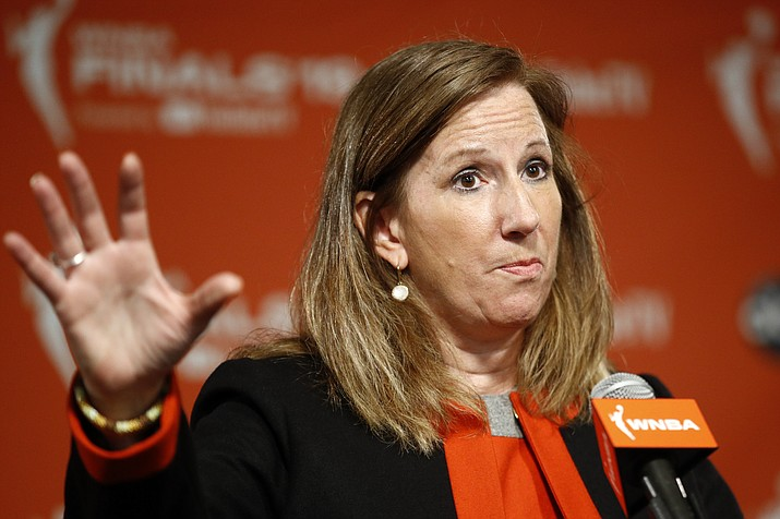 In this Sept. 29, 2019, file photo, WNBA Commissioner Cathy Engelbert speaks at a news conference before Game 1 of basketball's WNBA Finals in Washington. Engelbert said in a phone interview with The Associated Press on Friday, May 15, 2020, that the league is focusing on about a half dozen scenarios to play this summer during the coronavirus pandemic. Engelbert did not go into detail about each scenario, but said that they are looking at playing in either one or a couple of sites at most instead of at every home arena. (Patrick Semansky/AP, file)