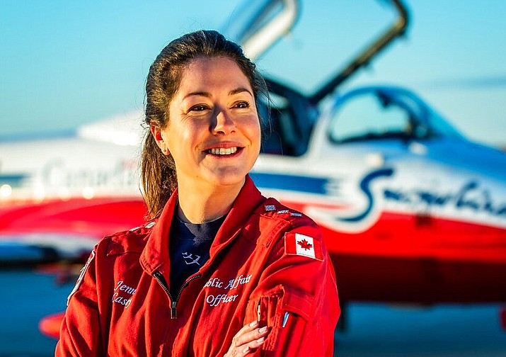 In this undated photo provided by the Royal Canadian Air Force, Capt. Jennifer Casey poses for a photo. A Canadian aerobatic jet crashed into a British Columbia neighborhood Sunday, May 17, 2020, during a flyover intended to boost morale during the pandemic, killing Casey, seriously injuring another crew member and setting a house on fire. (Royal Canadian Air Force via AP)