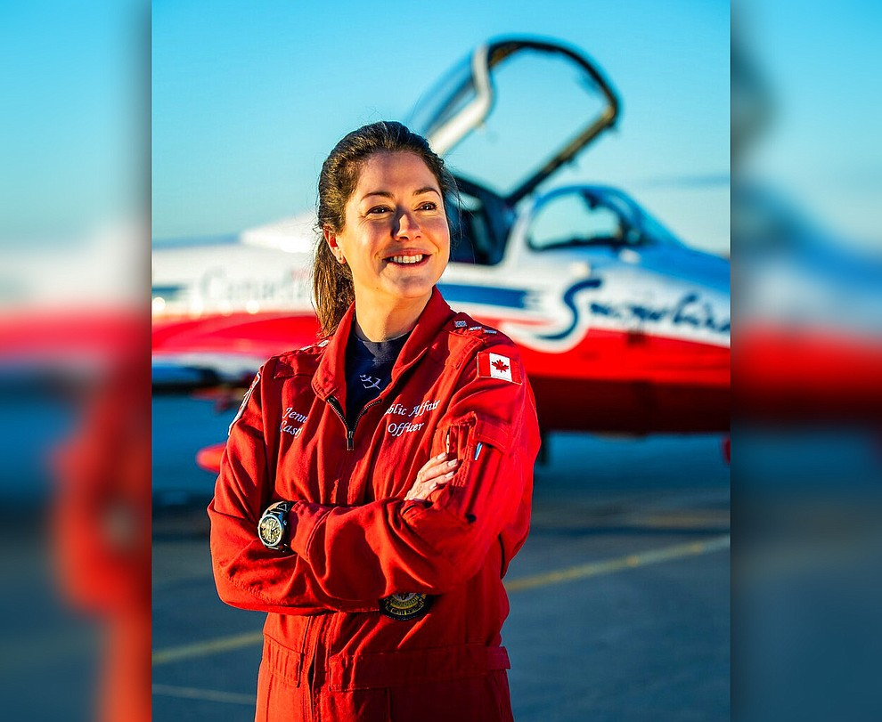 In this undated photo provided by the Royal Canadian Air Force, Capt. Jennifer Casey poses for a photo. A Canadian aerobatic jet crashed into a British Columbia neighborhood Sunday, May 17, 2020, during a flyover intended to boost morale during the pandemic, killing Casey, seriously injuring another crew member and setting a house on fire.(Royal Canadian Air Force via AP)