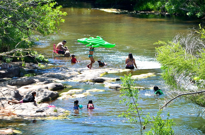People hang out in Oak Creek in Page Springs as they try to escape coronavirus isolation and get some sunshine. VVN/Vyto Starinskas