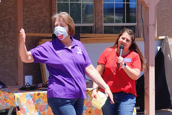 Chino Valley Chamber of Commerce Executive Director Lorette Brashear, right, introduces Donna Moehring as she models her face mask for the fashion show during the Chino Valley Chamber of Commerce's luncheon on Thursday, May 14, 2020, in Chino Valley. (Aaron Valdez/Review)