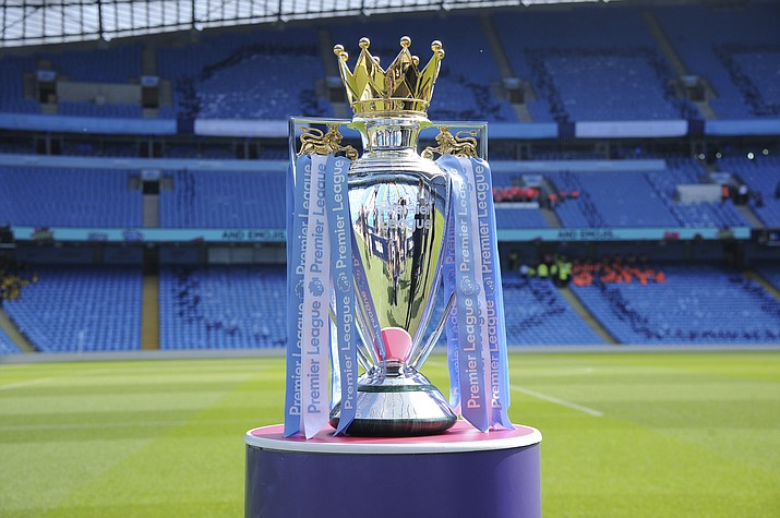 In this Sunday, May 6, 2018 file photo, the English Premier League trophy is displayed on the pitch prior to the English Premier League soccer match between Manchester City and Huddersfield Town at Etihad stadium in Manchester, England. Steve Parish, the chairman of Crystal Palace, says the Premier League could face years of legal challenges if this season is not completed due to the coronavirus pandemic. (Rui Vieira/AP, file)