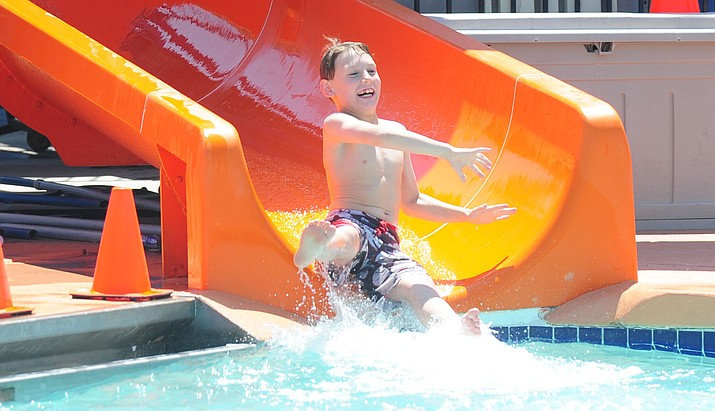 2015 file photo of Ethan McKay as he comes down the slide at the Prescott Valley Mountain Valley Splash. (Courier file photo)