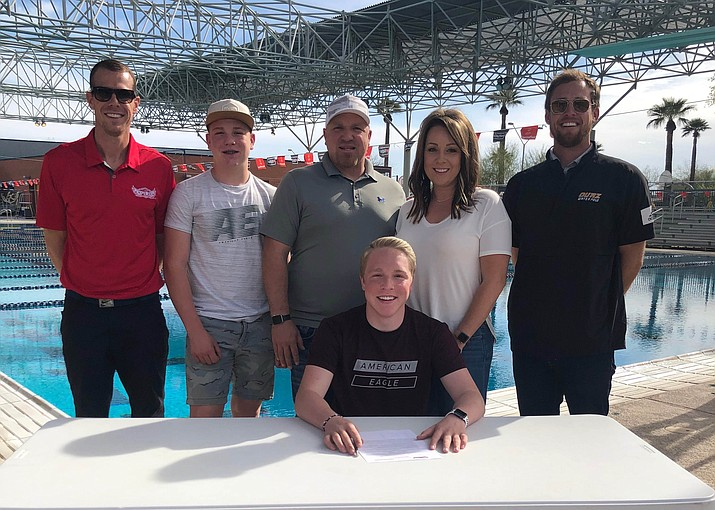 Prescott swimmer Blake Francis, bottom, takes a photo with his family after signing his letter of intent to continue his athletic career at Ottawa University in Phoenix. (Blake Francis/Courtesy)