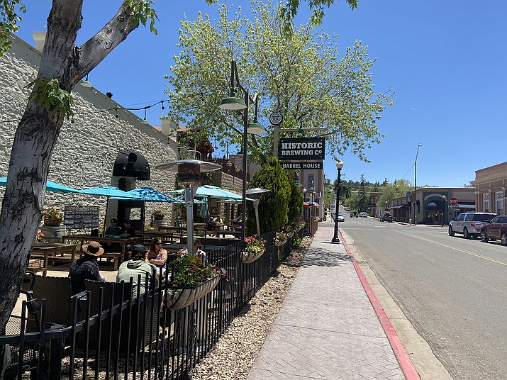 The town of Williams showed signs of an economic revival as restaurants, bars and retail shops opened this week. Patrons enjoy the sunshine on the patio of the Historic Brewing Company May 14. (Wendy Howell/WGCN)