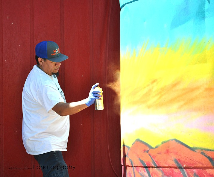 Jerrel Singer works on a mural at Hank's Trading Post on Highway 89, which the owners would like to be the start of a 'Highway of Hope' for artists and people who live close to the highway. (Photo courtesy of Stephanie Dann Photography)