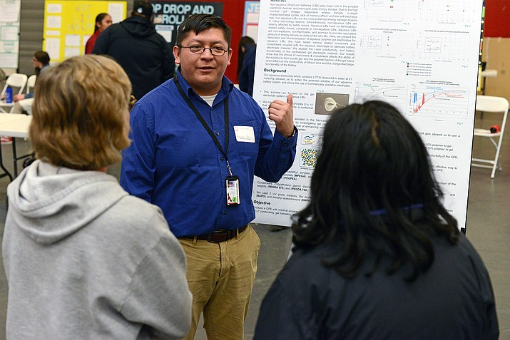 Spring Graduate candidate Robinson Tom presents research on non-aqueous lithium-ion batteries at NTU's annual Research Day competition. Tom will be the first graduate of NTU's Bachelor of Science degree program in Biology. (Photo courtesy of Navajo Technical University)