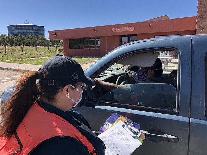 Staff at Diné College distribute CARES Act checks to students at the Tsaile campus May 13. (Photo courtesy of Diné College)
