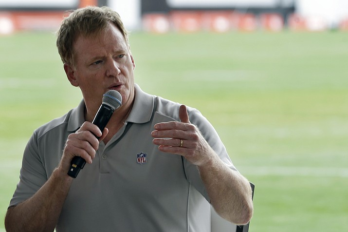 In this Aug. 17, 2017, file photo, NFL Commissioner Roger Goodell answers questions during a season ticket member fan forum before practice at the Cleveland Browns NFL football team's training camp facility in Berea, Ohio. Several NFL teams are reopening their training facilities Tuesday, May 19, 2020, while many are prohibited by government restrictions during the coronavirus pandemic. Commissioner Roger Goodell gave the 32 clubs the go-ahead for limited reopenings as long as state and local municipalities allow them. (Tony Dejak/AP, file)