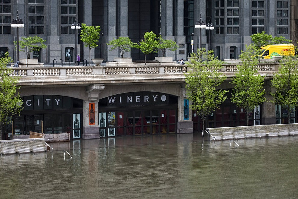 The Chicago River overflowed its banks and flooded the Riverwalk after overnight showers and thunderstorms across the city Monday, May 18, 2020 in Chicago. (Ashlee Rezin Garcia/Chicago Sun-Times via AP)