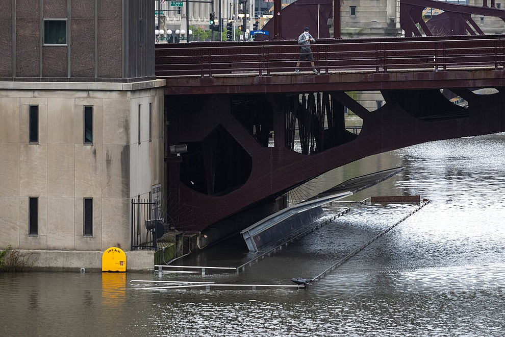 The Chicago River overflowed its banks and flooded the Riverwalk after overnight showers and thunderstorms across the city, Monday, May 18, 2020 in Chicago. (Ashlee Rezin Garcia/Chicago Sun-Times via AP)