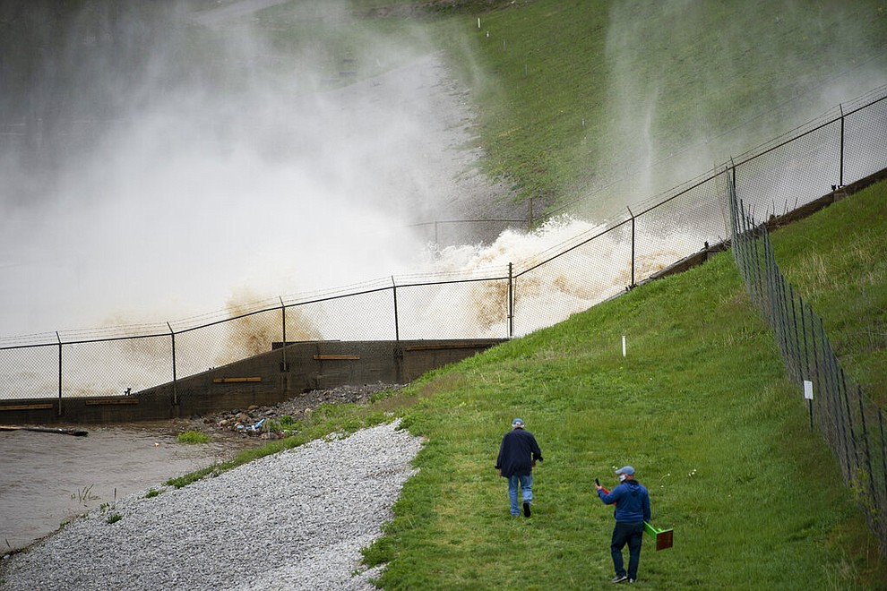 This photo shows a view of a dam on Wixom Lake in Edenville, Mich., Tuesday, May 19, 2020. People living along two mid-Michigan lakes and parts of a river have been evacuated following several days of heavy rain that produced flooding and put pressure on dams in the area. (Kaytie Boomer/The Bay City Times via AP)