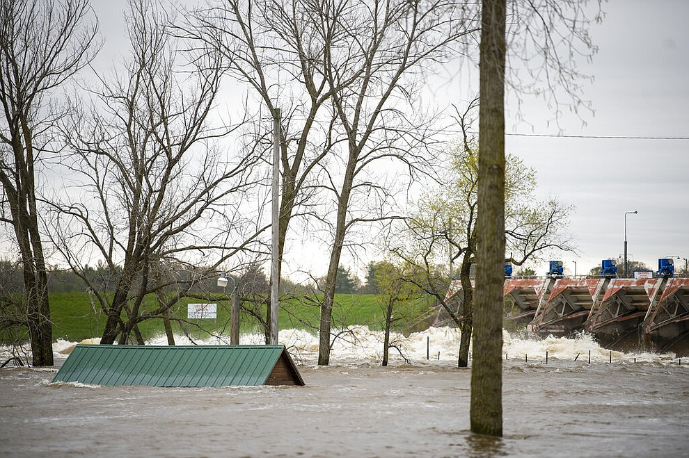 A view of the flooded area near the Sanford dam on Tuesday, May 19, 2020. Residents were told to evacuate due to the dams on Sanford and Wixom Lakes no longer being able to control or contain the amount of water flowing through the spill gates. (Kaytie Boomer/MLive.com/The Bay City Times via AP)
