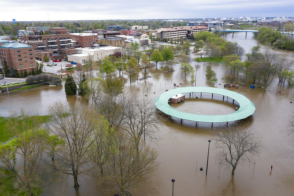 Water floods the Midland Area Farmers Market and the bridge along the Tittabawassee River in Midland, Mich. on Tuesday, May 19, 2020. (Kaytie Boomer/MLive.com/The Bay City Times via AP)