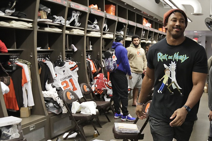 In this Dec. 30, 2019, file photo, Cleveland Browns defensive end Myles Garrett walks through the locker room at the NFL football team's training camp facility in Berea, Ohio. The NFL is taking baby steps toward full reopenings for its teams. It has no other choice. Consider social distancing. This could be the most difficult task of all. (Tony Dejak/AP, file)