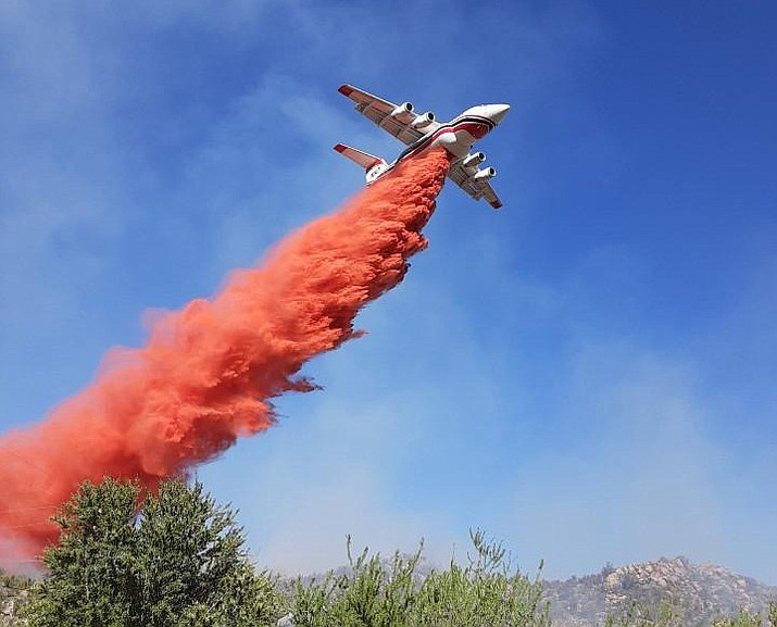 A slurry bomber passes over the Park Fire in Bagdad as firefighters work to put out the blaze Thursday, May 21, 2020. (YCSO/Courtesy)
