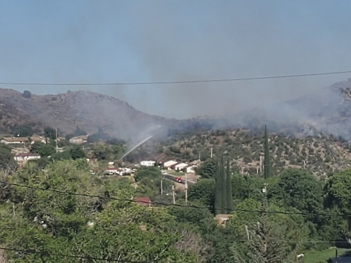Smoke from the Park Fire in Bagdad, west of Prescott, rises from the area of Lindahl, Navaho and East Park drives. (Dalton Mills/Courtesy)