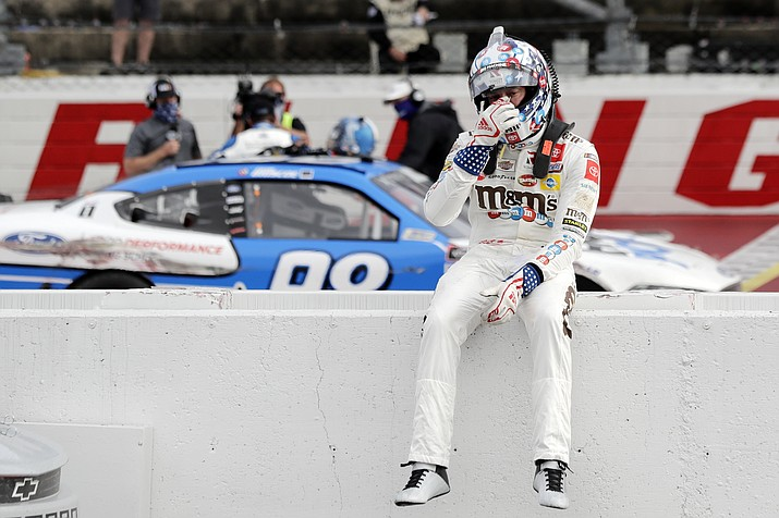 Kyle Busch sits on the wall as Chase Briscoe celebrates behind him after Briscoe edged out Busch to win the NASCAR Xfinity series auto race Thursday, May 21, 2020, in Darlington, S.C. (Brynn Anderson/AP)