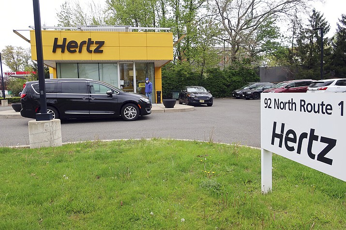 In this May 6, 2020, file photo, a Hertz car rental is closed during the coronavirus pandemic in Paramus, N.J. Hertz filed for bankruptcy protection Friday, May 22, 2020, unable to withstand the pandemic that has crippled global travel and with it, the heavily indebted 102-year-old car rental company's business. (AP Photo/Ted Shaffrey, File)
