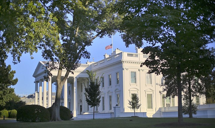 In this file photo, the U.S. flag is seen at half-staff at the White House in Washington, D.C. (Pablo Martinez Monsivais/AP, file)