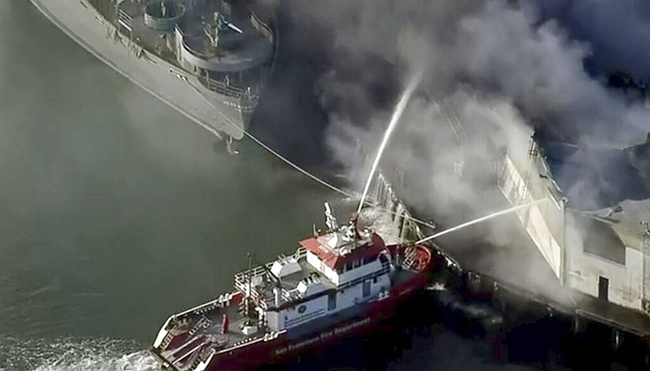 First responders battle a massive fire that erupted at a warehouse early Saturday, May 23, 2020 in San Francisco. Arriving crews were confronted with towering flames engulfing the warehouse. (KPIX-TV CBS-Viacom via AP)
