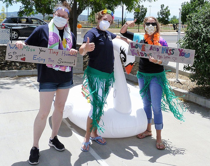 """Hundreds of families made their way through the """"backwards parade"""" Saturday, May 23, at both Acorn Montessori Charter School campuses in Prescott Valley. (Acorn Montessori Charter School/Courtesy)"""
